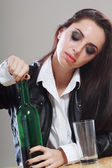 Woman in depression drinking alcohol — Stock Photo