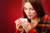 Woman drinking hot drink — Stock Photo