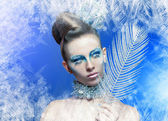 Woman with silver blue artistic make-up — Stock Photo