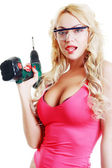 Blond woman with drill — Stockfoto