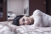 Girl lying on the bed — Stock Photo