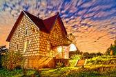 Stone house at sunset — Stock Photo