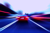 Speed motion car on street — Stock Photo