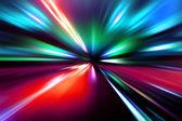 Speed motion on night road — Stock Photo