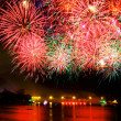 Stock Photo: Fireworks over water