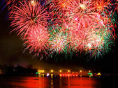 Fireworks over water — Stock Photo