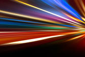 Speed motion on night road — Stock Photo