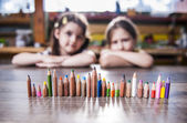 Children and pencils lined up in a row — Stock Photo