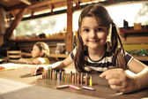 Little girl playing with pencils — Stock Photo