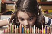 Smartest girl looking at pencils — Stock Photo