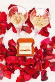 Wedding rings of rose petals — Stock Photo