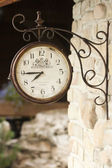 Old clock on a brick wall — Stock Photo