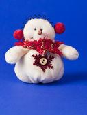 Vit snögubbe i röd halsduk — Stockfoto