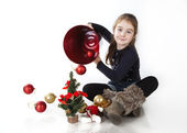 Lovely little girl playing with Christmas toys, white background — Stock Photo