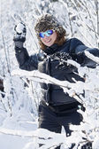 Young girl throwing snowballs — Stock Photo