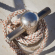 Mooring bollard with nautical rope — Stock Photo #17390107