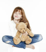 Red-haired teen girl and teddy bear — ストック写真