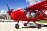 Red two-seater mini plane — Stock Photo
