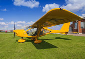 Yellow two-seater mini plane — Stock Photo