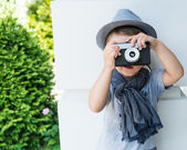 Little boy with a camera — Stock Photo
