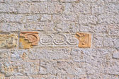 Part of walls of Old Church of red bricks Italy — Stock Photo