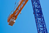 New blue elevating crane with suspension. — Stock Photo
