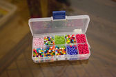 Multi-colored beads in a box — 图库照片
