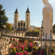 Stock Photo: Church and statue of Madonnof Medjugorje