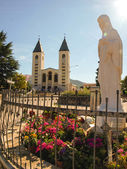 Church and statue of Madonna of Medjugorje — Stock Photo