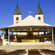 The altar in the square and church in Medjugorje — Stock Photo #14260083
