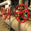 Stock Photo: Pipes and valves with red knobs