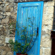 Blue door cabinet as a closed street stall in Mostar — Stock Photo #21012255