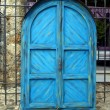 Blue door cabinet as a closed street stall in Mostar — Stock Photo #21012259