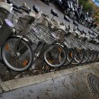 Bicycles in a row, a public bike sharing system in Paris — Stock Photo