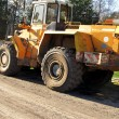 Stock Photo: Bulldozer, road roller, earthmoving machinery and road construct