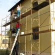 Stock Photo: Application of colored plaster on facade of building