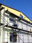 Priming the facade of the building before applying the plaster, — Stock Photo