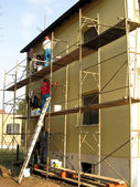 Application of colored plaster on the facade of the building — Stock Photo