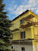 Scaffolding around the building — Stock Photo