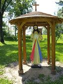 Koden shrine, the Merciful Jesus figure in folk style — Stock Photo