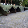 Stock Photo: Several large military tents on paved area