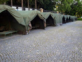 Several large military tents on the paved area — Stock Photo