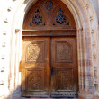 Stock Photo: Wooden door to Church of St. Peter in Trento