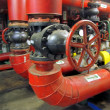 Stock Photo: Big red gate valve on water pipe
