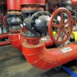 Big red gate valve on water pipe — Stock Photo #35985441
