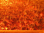 Flame and hot slag on the grate coal-fired boiler with a mechani — Stock Photo