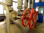 Ipes and valves with red knobs — Foto de Stock