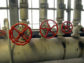 Ipes and valves with red knobs — Stock Photo