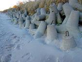 Concrete breakwater for winter beach in Mielno — Stock Photo