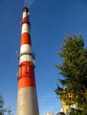 High red-white concrete industrial chimney — Stock Photo